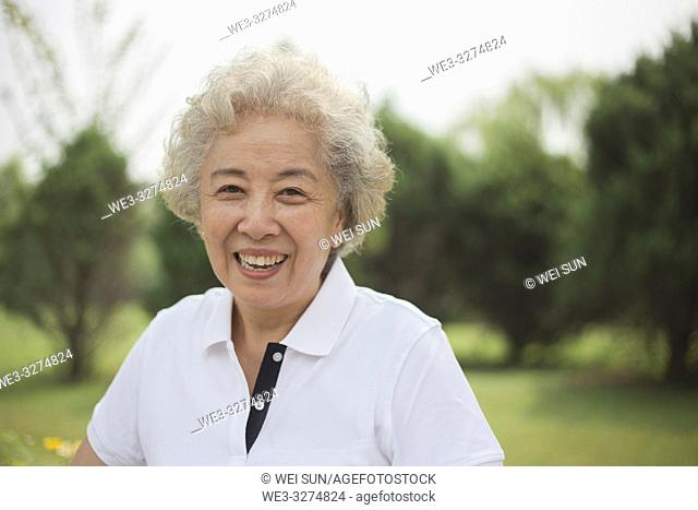 Elderly woman outdoors, healthy life