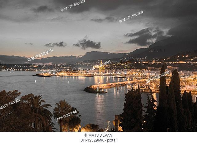 Lights Illuminating The Cityscape Along The Mediterranean; Menton, Cote D'azur, France