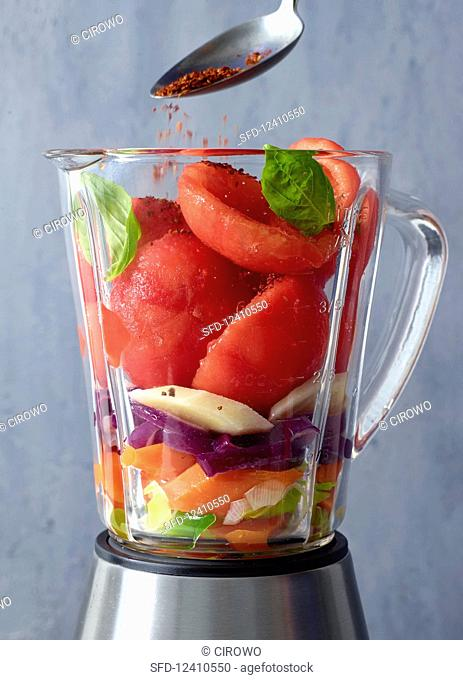 Ingredients for tomato soup in a blender