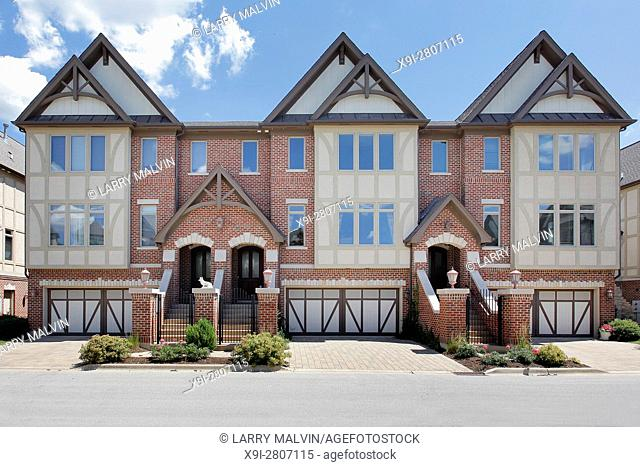 Row of tudor style brick townhouses with front gates. Western Suburbs of Chicago, IL. USA