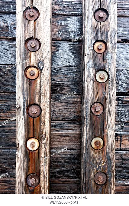 Wood and bolts abstract on docks in Crow Head, Twillingate, Newfoundland, Canada