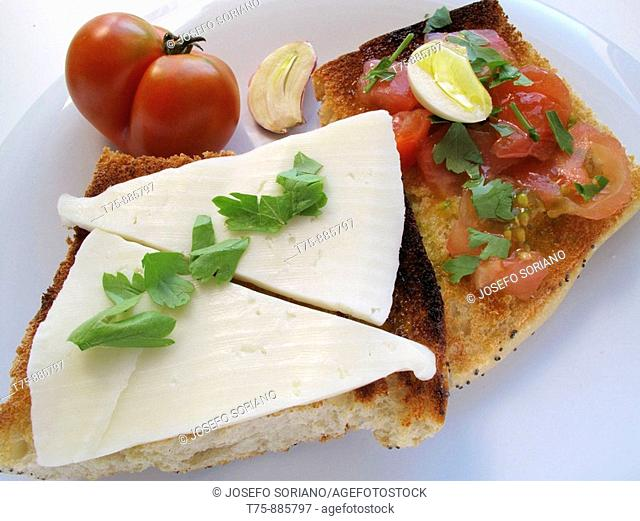 Toast with olive oil, garlic, sweet tomato and cheese