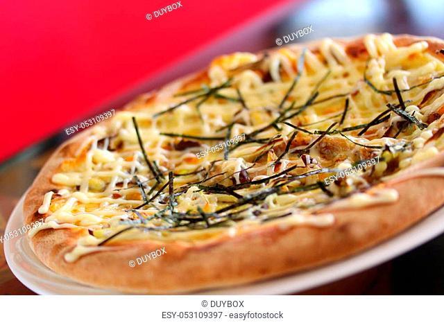 Teriyaki Chikinpiza or Japanese chicken Pizza on white dish