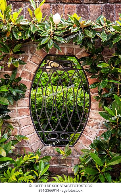 Detail of a wrought iron fence in a brick wall in Charleston South Carolina