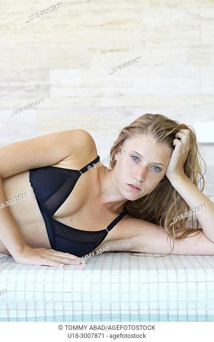 Blonde girl in black bikini