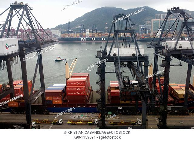 Aerial view from the Hong Kong harbor container terminal while a container ship is loaded with container, China, Far East Asia