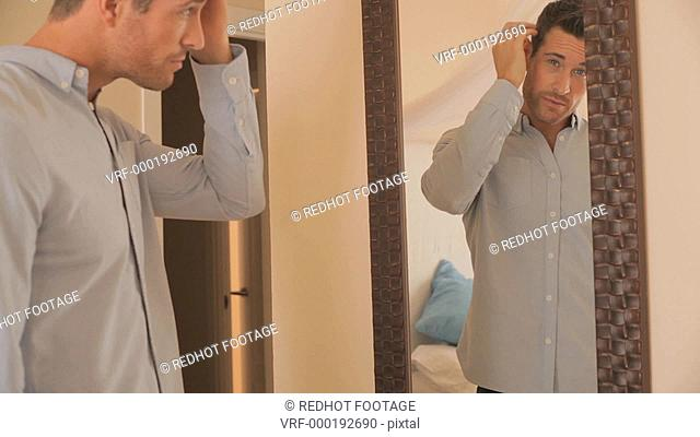 Dolly shot of couple in bedroom hugging in mirror