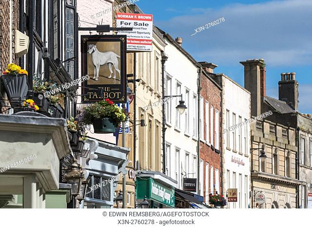 UK, England, Yorkshire, Richmond - A strip of local shops in the city of Richmond located in Northern Yorkshire