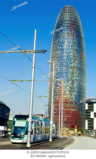 Agbar Tower (142 m. ) by Jean Nouvel and tram, Plaça de les Glòries, Barcelona. Catalonia, Spain