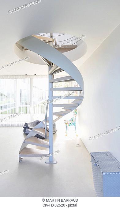 White spiral staircase in modern home showcase interior