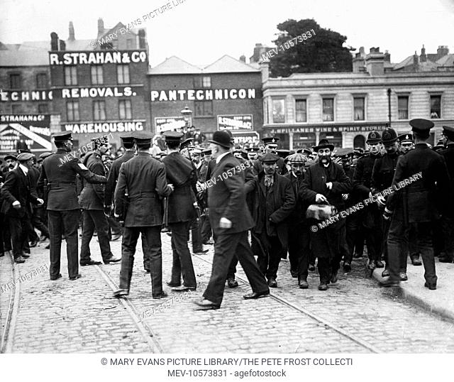 Police holding strikers back to allow non-union men to pass to Kingsbridge Station (now known as Heuston Station) in Dublin, Ireland