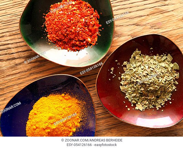 Cooking ingredients, herbs on a wooden rustic table