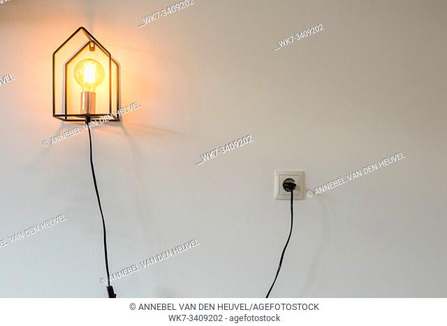 modern pendant light with vintage light bulb, modern urban design on wall