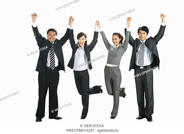 Four business people holding hands,cheering
