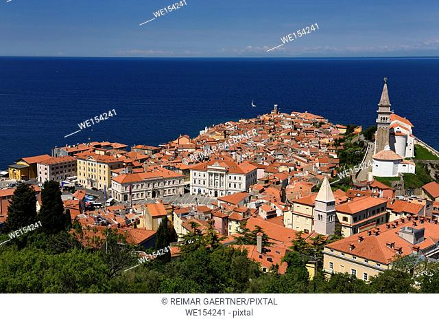 Cape Madonna at Point of Piran Slovenia on blue Adriatic Sea with Tartini Square courthouse City Hall and St George's Catholic church