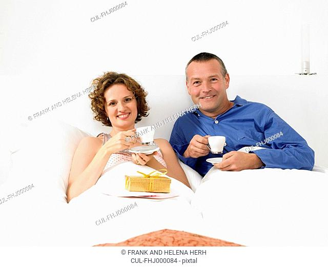 Portrait of man and woman in bed