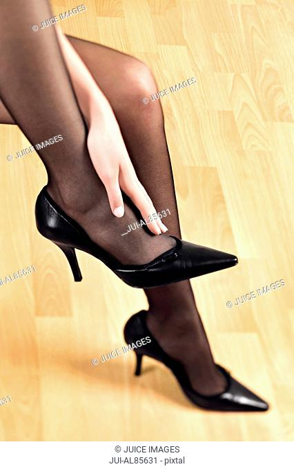 Close up of woman's legs in pantyhose and high heels