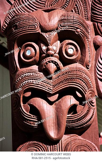 Maori wooden carving with tongue sticking out, Rotorua, North Island, New Zealand, Pacific