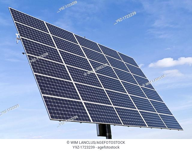 Solar panels against clear blue sky