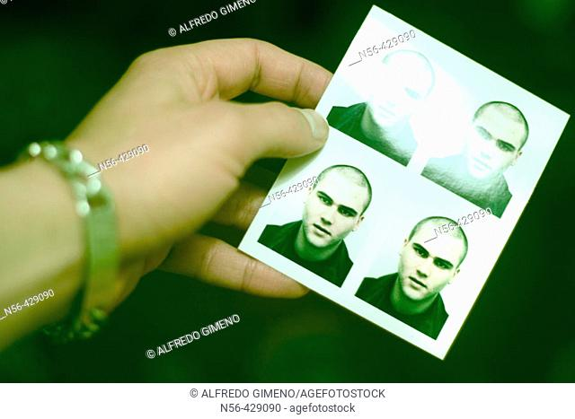 Hand holding photographs