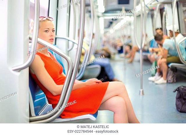 Lady traveling by metro