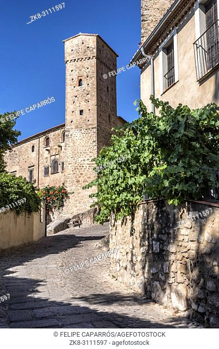 Trujillo, Spain - July 14, 2018: Torre de los enamorados, next to Romanesque tower of the Church of Santiago and that of the strong house of Luis Chaves