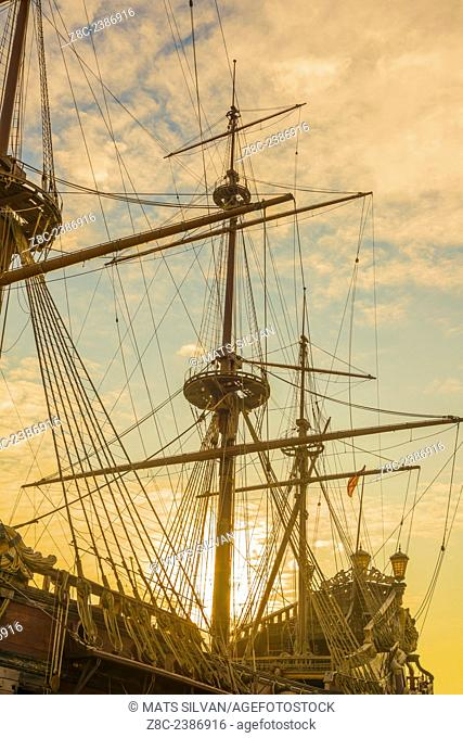 Old sailing ship in sunset in Genoa, Italy