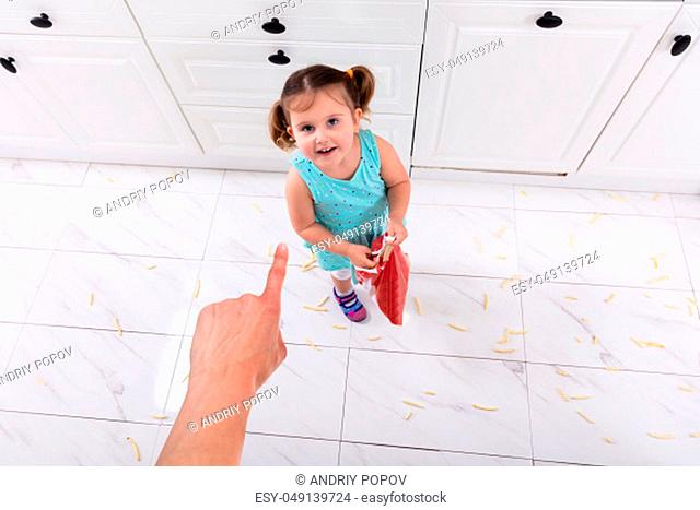 An Overhead View Of Cute Girl Looking At Person's Hand Pointing On Her