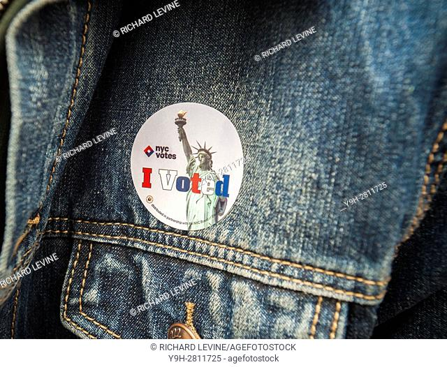 A voter wears her ''I Voted'' sticker on Election Day in New York on Tuesday, November 8, 2016