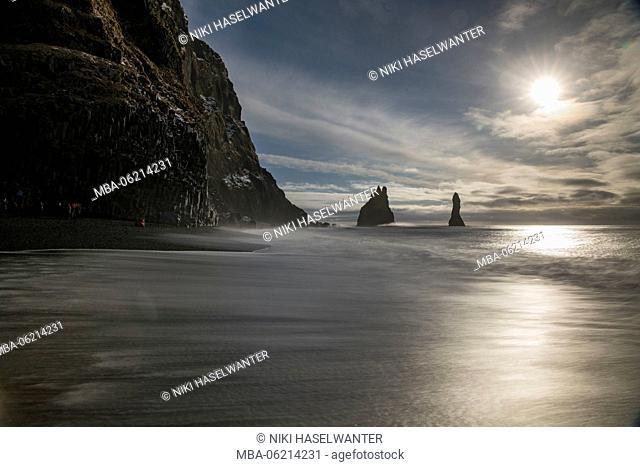 Long exposure on Reynisfjara beach in Iceland, sun, backlight