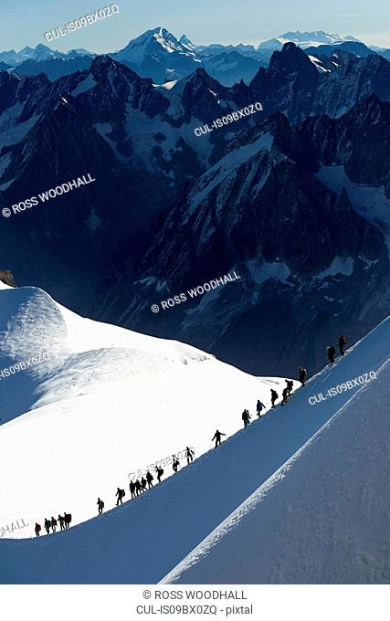 Mountain climbers on descent in distance, Chamonix, Rhone-Alps, France