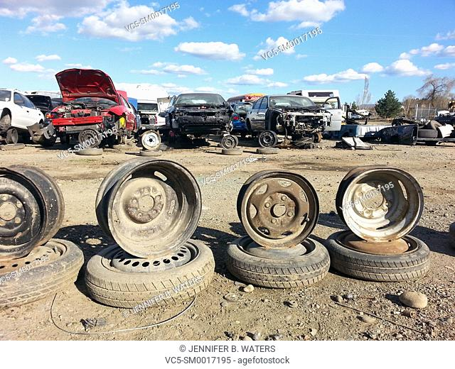 Welded wheels to hold up damaged vehicles at the scrap yard