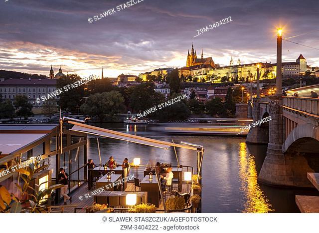 Night falls on Vltava river in Prague