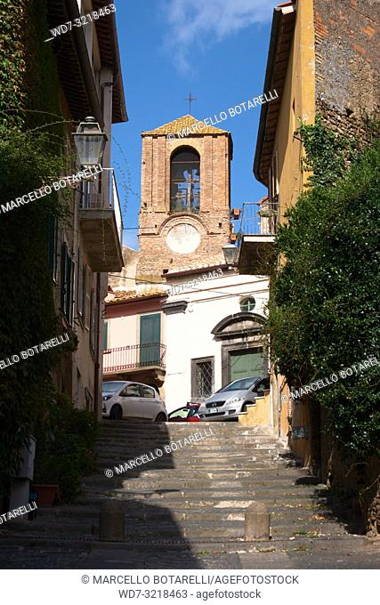 ancient road and bell tower of the church of the assunta, anguillara sabazia, lazio, italy
