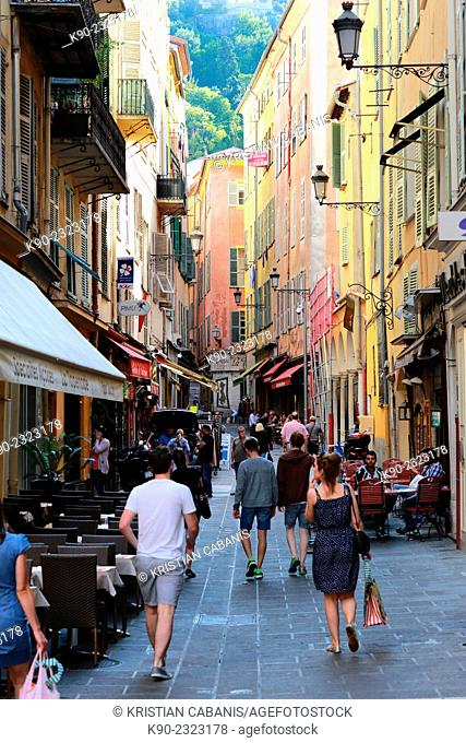 Pedestrian street in the old town of Nice with neoclassical buildings, France, Europe