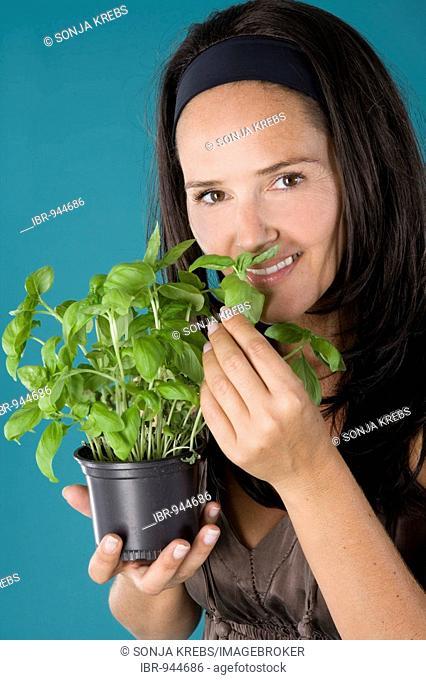 Girl smelling basil