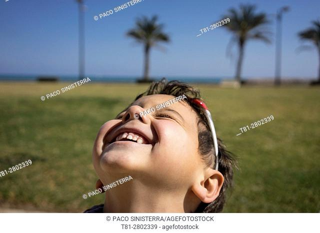smiling boy looking at the sky, Alboraya.Valencia