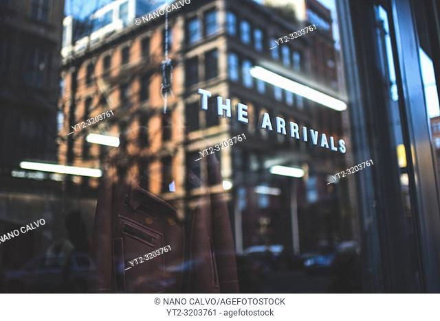 Reflection on The Arrivals clothes store, SoHo, New York