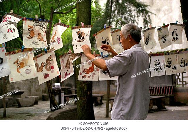 Man selling chinese traditional paintings at the Qingyang Temple, Chengdu, Sichuan Province, China, July 2004