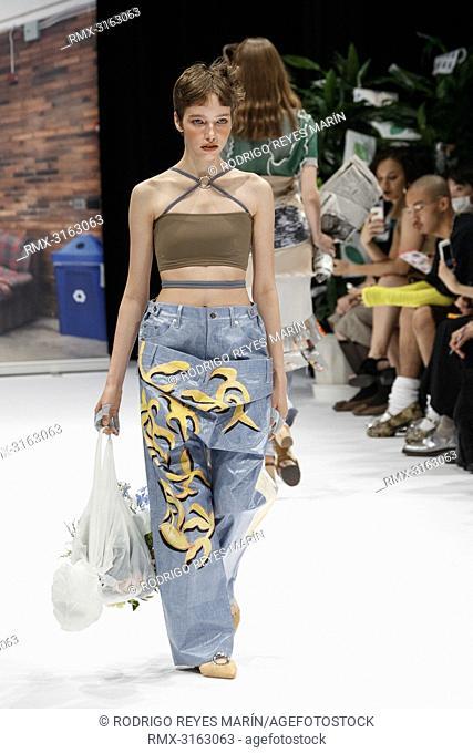 October 17, 2018, Tokyo, Japan - Models wearing fashion brand 'kotohayokozawa' walk down the catwalk during the Amazon Fashion Week TOKYO 2019 S/S collection at...