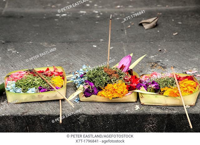 Religious offerings of flowers and food left on the steps of a Hindu temple in Legian, Southern Bali, Indonnesia