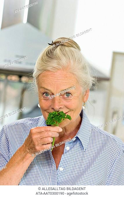 Elderly lady with parsley