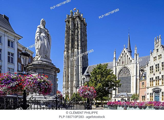 Statue of Archduchess Margaret of Austria and the St. Rumbold's Cathedral in the city Mechelen / Malines, Antwerp, Flanders, Belgium