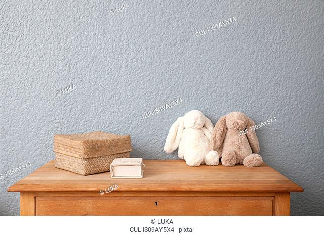 Soft toys on chest of drawers in baby's nursery
