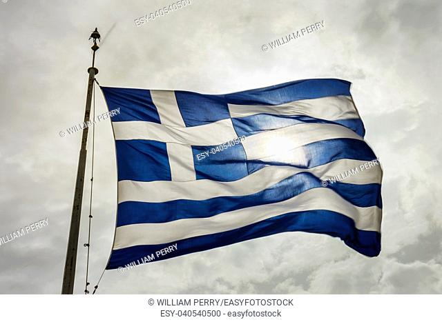 Blue White Greek Flag Sun Summit Acropolis Athens Greece. Cross symbolizes Greek Orthordox Chritiianity, the religion of Greece, Acropolis is symbol of Athens
