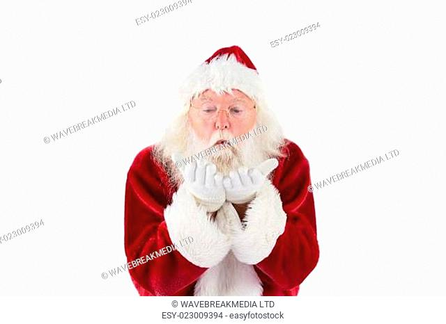 Santa Claus blows something away