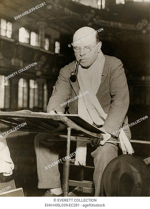 Pablo Casals at rehearsal conducting the Barcelona Philharmonic Orchestra. Casals generally appears at rehearsal in a scarf around his neck and a pipe between...