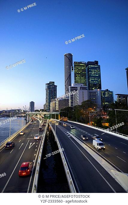 Traffic on Pacific Motorway and Brisbane city skyline, Australia