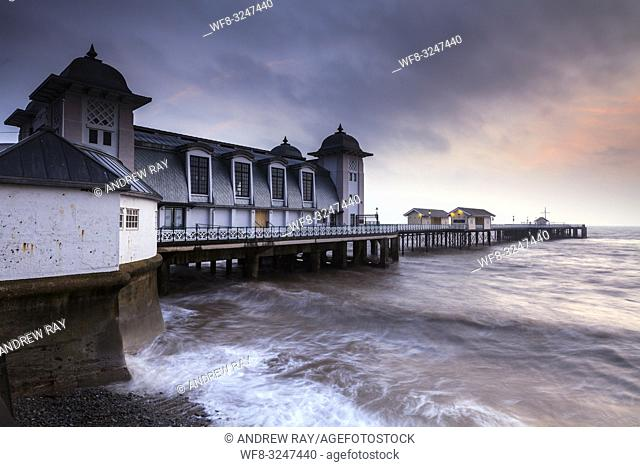 The Victorian era pier at Penarth in South Wales, captured on a stormy morning in mid February when high tide coincided with sunrise