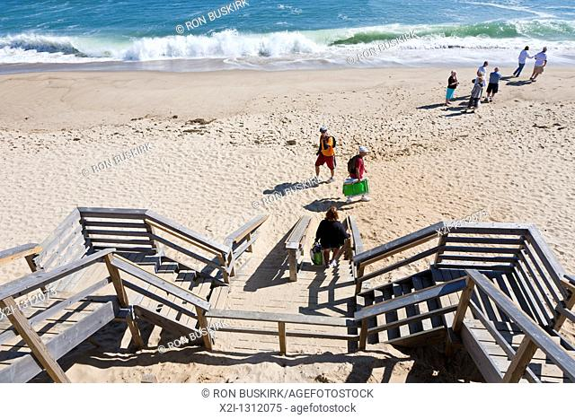 Beach visitors use wooden stairs at entrance to Nauset Light Beach in Eastham, Massachusetts